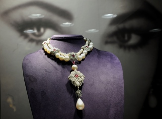"""La Peregrina"", a Cartier pearl, diamond and ruby necklace owned by US actress Elizabeth Taylor on display during a preview of The Collection of Elizabeth Taylor December 1, 2011 at Christie's in New York. The jewelry in Taylor's collection will go on sale December 13, this necklace is estimated at USD 2 million to 3 million. AFP PHOTO/Stan HONDA (Photo credit should read STAN HONDA/AFP/Getty Images)"