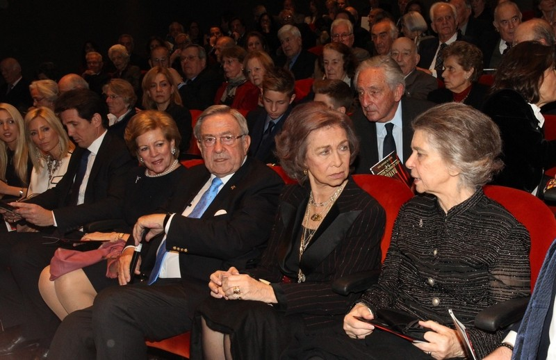 Queen Sofia speaking with her sister, Princess Irene, and sitting next to King Constantine.