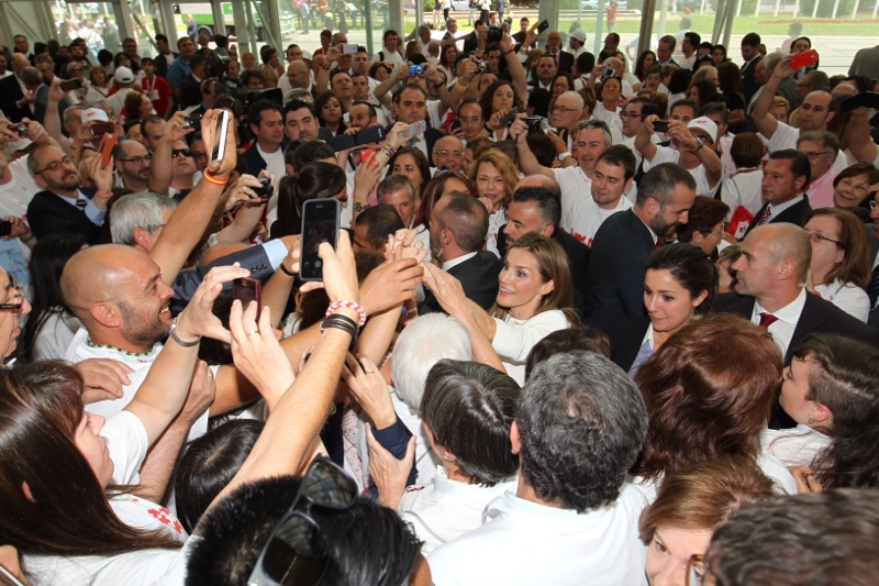 Queen Letizia gets mobbed by crowds during a Spanish Red Cross event.